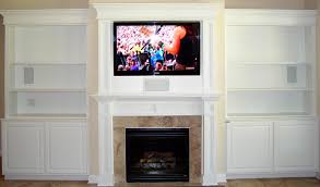 furniture white wooden cabinet with shelves and storage also television on the middle above the