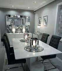 In this room, the walls are painted a shade of gray that is almost sage, and as a result of the charcoal and black furniture pop against it. Modern Dining Room Decor Ideas Fantastic Gray Vibes Walls Decorating Idea Wall Bac Ojj