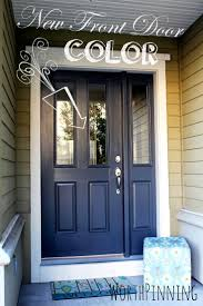 blue door house. Brown House Entrance With Blue Grey Door Featuring Chic Dark Small Glass Decoration And Floral Poufs Design O