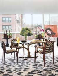 ontemporary dining room by workac in a dining area of diane von furstenberg s manhattan an andy warhol portrait of the designer is displa near