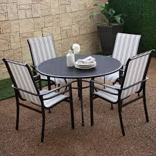 Stripping Dining Room Table Round Black Iron Table With Four Legs Combined With Black Chairs