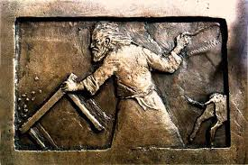 a picture of Jesus with a whip in his hand overturning a table carved  into a bronze cathedral door