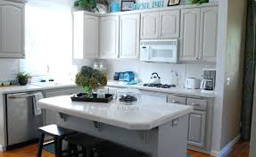 grey brick backsplash light gray shaker kitchen cabinets pattern fancy glass coffee jug black frame window white