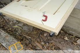 diy rolling barn doors add casters to bottom of doors
