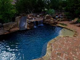 Freeform Pool Spa with Grotto Waterfall and Rock Pond