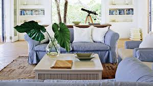coastal living room design. Large Banana Leaves Are Arranged In A Glass Vase On The Coffee Table With White Coastal Living Room Design