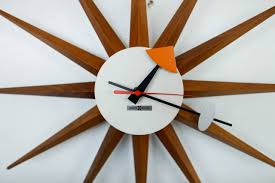 wall clock with walnut spikes and enameled metal face hands working condition made george nelson t65