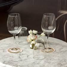 a marble table with two wine glasses on it