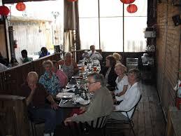 kiwanis social activity north shore kiwanis reporter chicago  a table full of kiwanis