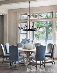 a lola chandelier from bungalow clic hangs above the round elm dining table floors throughout the first level are wide plank oak
