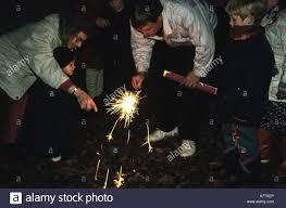 The Lighting Guy Family Celebrating Guy Fawkes Night Lighting Sparklers Stock