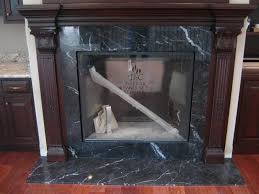black marquina marble fireplace surround and hearth