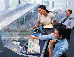 Stock Brokers Stock Brokers And Manager Trying To Solve Problem Stock Photo