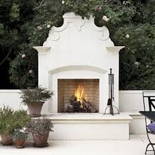 love this outdoor fireplace so pretty and classic