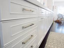 white kitchen raised panel cabinets polished nickel drawer pulls hardware pulls metal silver