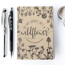 a little a6 lined notebook with a boho typographic design inspired by alice in wonderland written by lewis carroll on the cover by chatty nora
