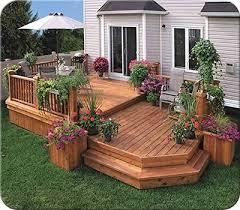 Backyard Decking Designs Unique This Twolevel Deck Design Creates An Eating Area And A Sitting Area