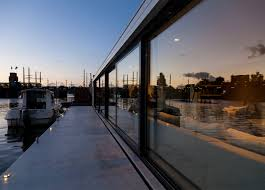 Floating home by +31 Architects moored on Amsterdam river ...