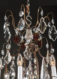 french patinated bronze and crystal louis xv chandelier with cut glass center bunches of amber crystal gs and amber and clear crystal teardrops