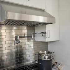 Cooktop With Stainless Steel Subway Tile Backsplash
