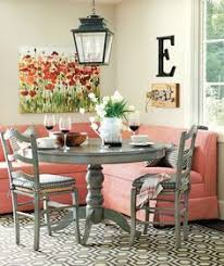 stylish breakfast nook with red banquette seating