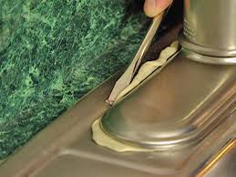 remove any excess putty from around escutcheon