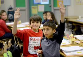 left raise their hands in ron berkson s gifted and talented education program cl also known as gate wednesday robinson z daily republic