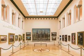 gallery with paintings and archways