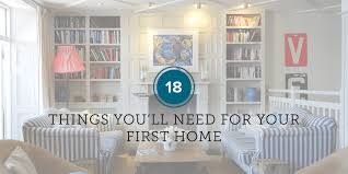Image Essentials Living Room With Two Sofas And Bookshelves Safewise 18 Things Youll Need For Your First Home Safewise