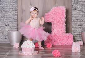 Cute Smiling Baby Girl In Pink Dress With Her First Birthday Stock