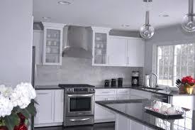 gray granite countertops with oak cabinets