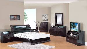 brown and white bedroom furniture. Charming Dark Brown Bedroom Furniture Set Combined With Glowing Unique Bed Design On White Fur Rug And Curved Drawer Chest Mirror Also Artsitic E