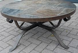 impressive round wrought iron coffee table with breathtaking black glass top