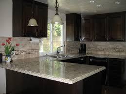 dark brown cabinets and giallo santo granite counter tops white granite countertops with dark cabinets