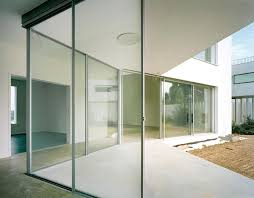 stunning clear glass wall design with aluminum frame also concrete floor