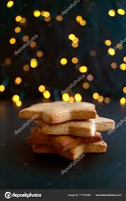 Cookies Star Shaped Folded Slide On The Background Lights Stock