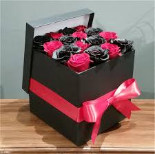 16 fresh roses in a box red and black checkers