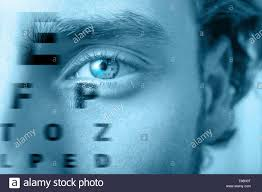 Man With Eye Chart Closeup Health Care Concept Stock Photo