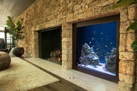 400 gallon in -wall custom aquarium fireplace-adjacent living-room
