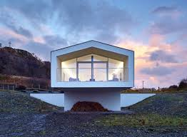 Cantilevered holiday home frames views of Scotland's Small Isles