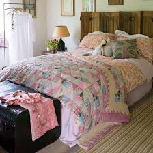 Take a patchwork quilt as your starting point, add a bold floral ... & Mix and match bedroom quilts, country style bedrooms Adamdwight.com