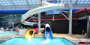 Indoor pool with slide Glass Playstop Cape Codder Resort The Cape Codder Water Park Cape Codder Resort