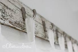diy reclaimed wood curtain rods with hooks via oliveandlove com
