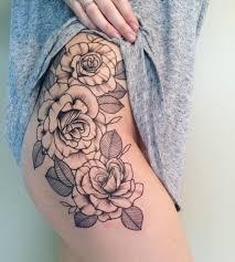 татуировки розы на бедре наколка на бедре две красные розы тату