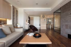 apartment living room ideas. Living Room, Interior Design For Apartments White Wall Paint Low Table Wooden Laminte Flooring Gray Apartment Room Ideas