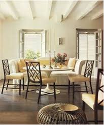 saarinen table with modern traditional chairs
