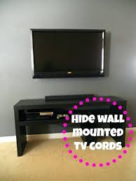 how to hide wires behind tv stand