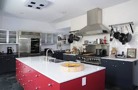 View in gallery Kitchen with white countertops, black shelves and a red  kitchen island