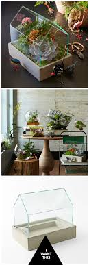 Green house effect. With its concrete base and simple, stylish design, this  glass