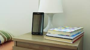 smartphone on bedside table next to the bed in bedroom - books - 4K stock  video